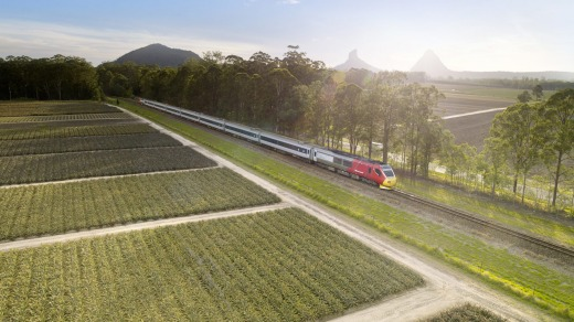 The Spirit of Queensland passes the Glass House Mountains.