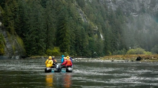 The group heads upriver in a Zodiac.