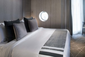 A Celebrity stateroom in muted shades.