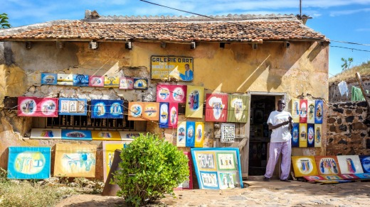 A Senegalese artist sells his paintings on the streets of Gorée Island, Dakar.