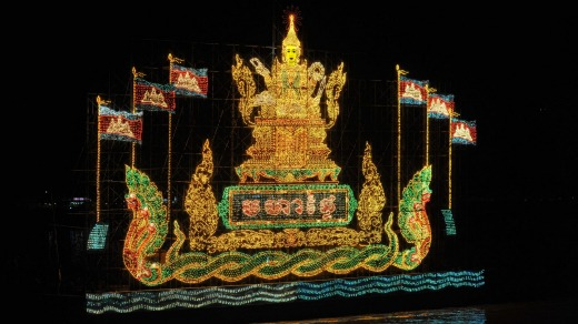An illuminated float with Cambodian flags during the water festival.