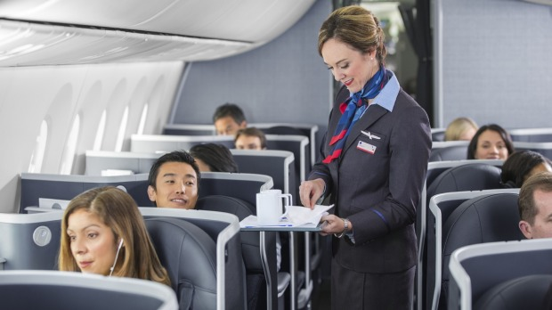 An American Airlines hostie in business class.