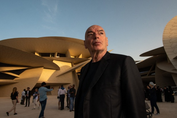 French architect Jean Nouvel poses in front of the National Museum of Qatar.