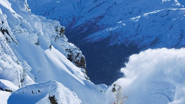 Snowboarding soft powder high in the Southern Alps.