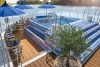 A sundeck and pool on Uniworld's Bon Voyage ship.