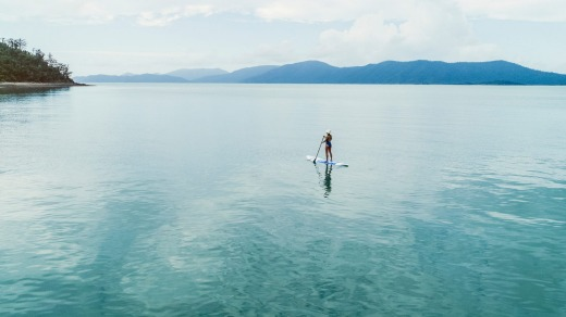 Stand-up paddle boarding in the Whitsundays.