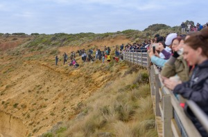 Tourists pose for photos outside the designated viewing area for the Twelve Apostlesat Port Campbell.  But the ...