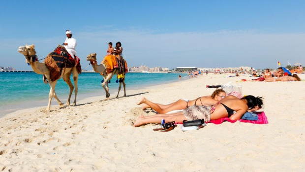 Tourists on a beach in Dubai. Dress codes are more relaxed in many Middle Eastern countries than you might think.