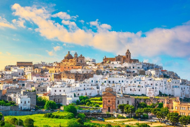 """OSTUNI  Capping a hilltop above gnarled olive trees on the plain below, Ostuni, largest of the so-called """"White Cities"""" ..."""