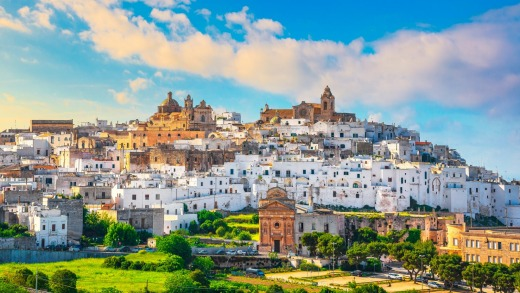 """Ostuni, the largest of the so-called """"White Cities"""", looks like a sugar-cube village transplanted from Greece's Cyclades ..."""