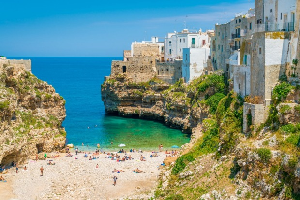 POLIGNANO A MARE  At heart, Polignano is just a seaside village yet its position, teetering on the brink of cliffs that ...