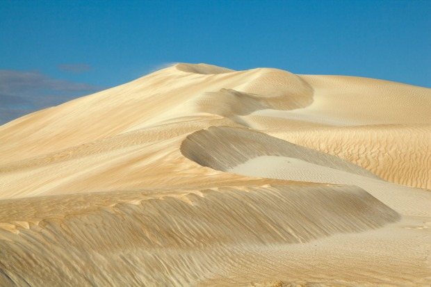 The isolated location adds to the mystique, and the combo of pink salt lakes and bright white dunes on the way down make ...