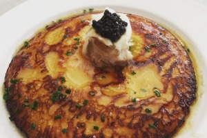 The smoked fish and caviar-topped Johnnycake at Neptune Oyster.