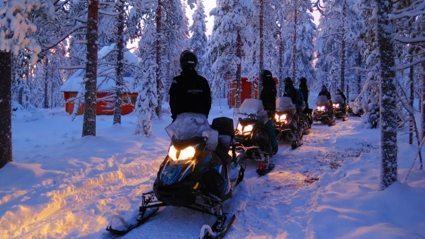 All wrapped up and off on a midday eSled safari in Finnish Lapland.