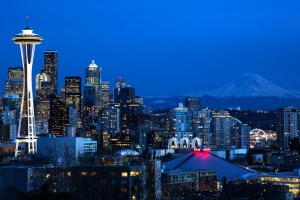 Seattle skyline with the Space Needle in the foreground and Mount Rainier in the distance.