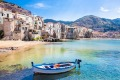 A wooden fishing boat at the beautiful harbour in Cefalu, Sicily.