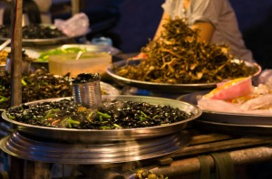 Snails, water beetles, frogs and crickets for sale at a street food market in Siem Reap.