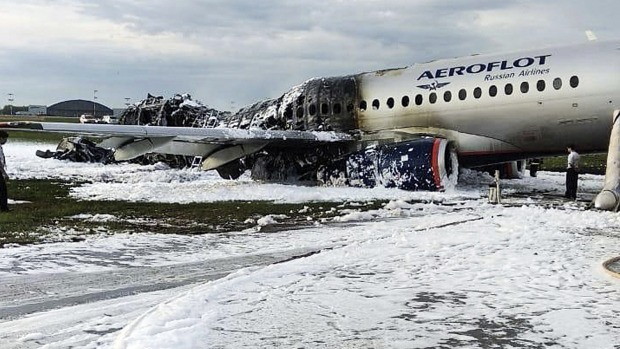 Some passengers took the time to get their carry-on bags before evacuating their burning Aeroflot plane.