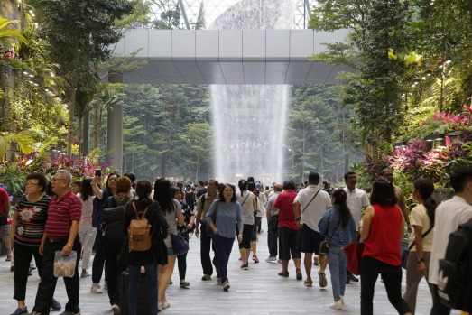 People walk inside the the Jewel Changi Airport during a media tour of the Jewel Changi Airport in Singapore, on ...