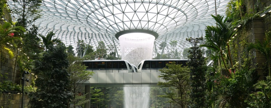 Skytrains sit on an elevated platform in front of the Rain Vortex at the Forest Valley garden during a media tour of the ...