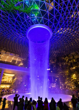 A Rain Vortex Light and Sound show in the night at Jewel Changi Airport, Singapore.