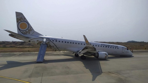A Myanmar National Airlines plane made a scheduled but emergency landing at Mandalay International Airport on only its ...