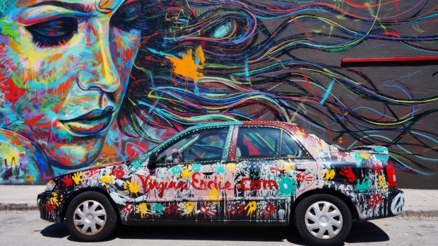 Colourful graffiti art line the street walls and back alleys of Miami, Florida.
