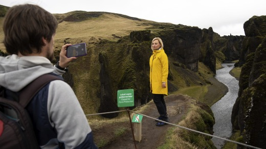 Russian tourist Nadia Kazachenok poses for a photograph at the canyon. Tourists jumped the gate as soon as the ranger ...