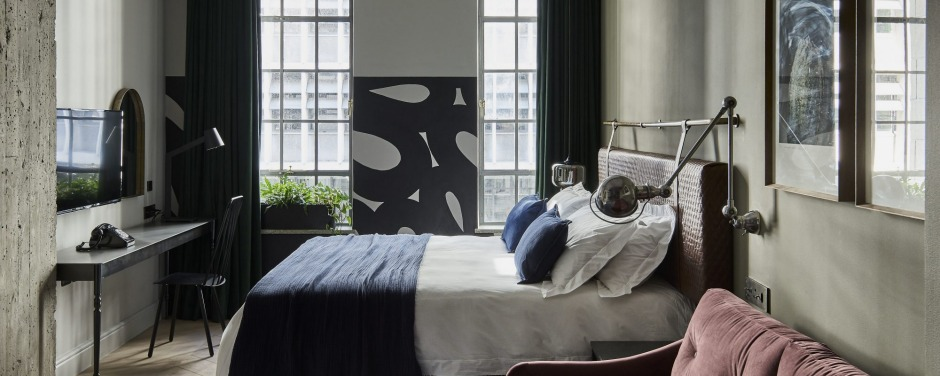 Rooms have a dark, moody palette and feature works by South African artists.