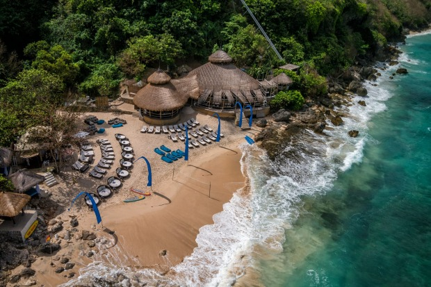 KARMA BEACH CLUB  There are 420-ish steps down to this beach-only club – or you can take the travelator, which slides ...