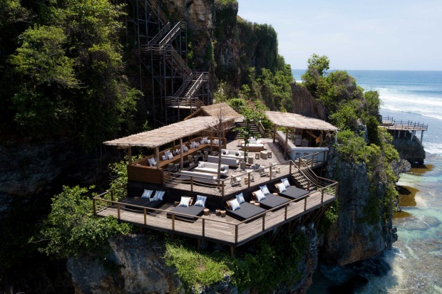 ULU CLIFFHOUSE  A luxury villa turned pool club five minutes from Uluwatu Temple, this split-level property has a ...