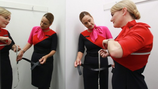 Qantas attendants try out their new uniforms after the current look's introduction in 2013.