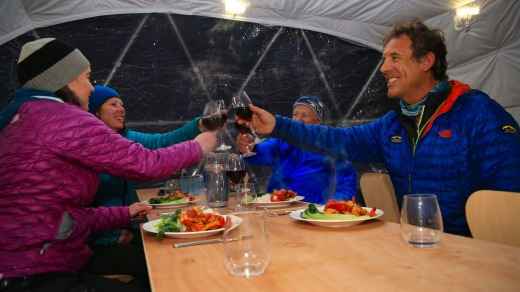 Inside the dome: Guy Cotter (right) and partner Suze Kelly (front left) raise a toast.