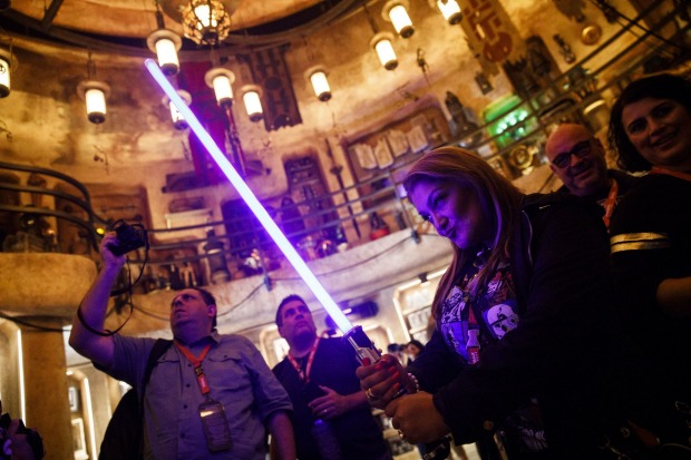 Inside Dok-Ondar's Den of Antiquities guests can purchase a lightsaber for about $US100 to $US150, depending on the type.