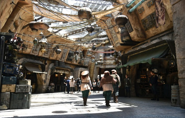Characters stroll through the marketplace at the Black Spire Outpost.