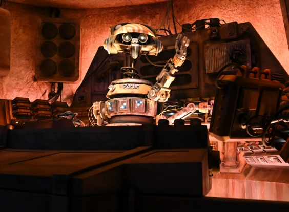 A droid DJ plays music inside Oga's Cantina.