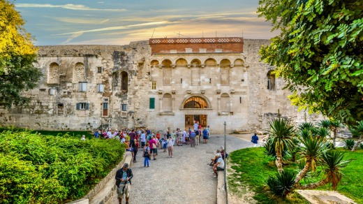 Tourists outside the ancient Golden Gate to the Diocletian's Palace section of the Old Town of Split, Croatia.