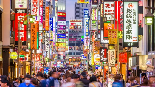 Crowds pass through Kabukicho in the Shinjuku district. The area is an entertainment and red-light district.