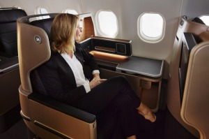 qf-airbus-a330-inflight-business-class-female-looking-through-window Qantas A330 business suites tra7-FlightTest