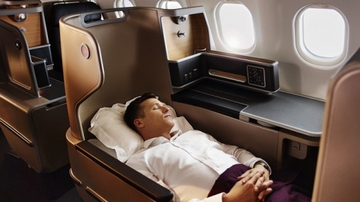Reclining in a Qantas A330 business suite.