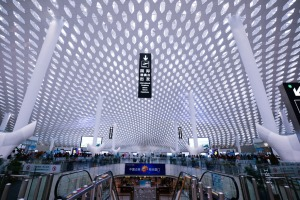 """A double-layered """"skin"""" whose honeycomb pattern bathes the terminal floor in dappled natural light."""