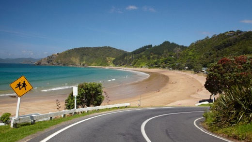 Oneroa Bay in the Bay of Islands is a worthy stop if taking a road trip around New Zealand's North Island.