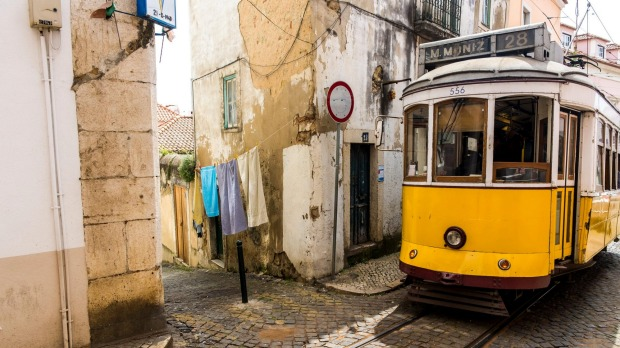 Lisbon's classic No. 28 tram en route through the Alfama district.