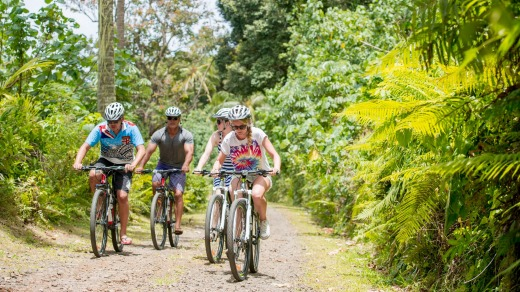 Tourists on a cycling tour in Rarotonga.