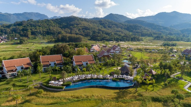 The semi-detached villas at the Pullman Luang Prabang, in Laos, are spread among working rice paddies.