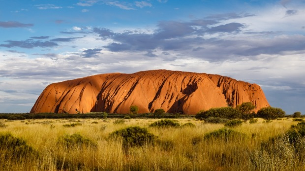 Uluru: That a big red rock in the middle of nowhere can lure in enough people to fill several direct flights a week is, ...