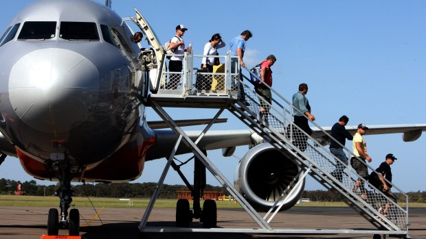 Australians have snapped up more than 200,000 half-price airfares on the first day of the government-subsidised sale.