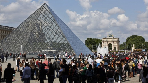 Tourists at the Louvre after it was closed following employee complaints about harassment by crowds waiting to see the ...