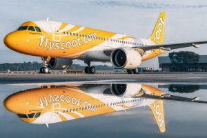 A Scoot Airbus A320 in its sunny livery.