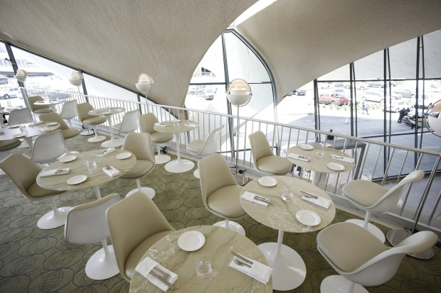 Tables are set for visitors in the Paris Cafe during the opening of the TWA Hotel at New York's John F. Kennedy ...
